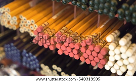 Lots of yellow pencils, stationery, a stationery store.
