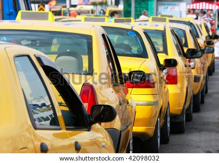 lots of yellow taxis in the street