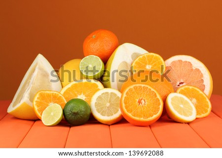 Lots ripe citrus on wooden table on orange background #139692088