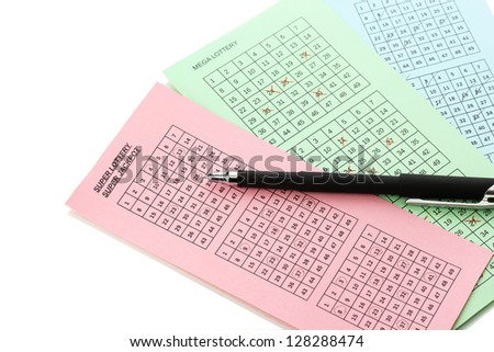 Lottery tickets and pen, isolated on white