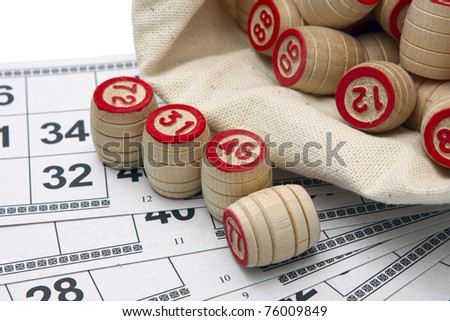Lotto game: wooden kegs in a sack and game cards