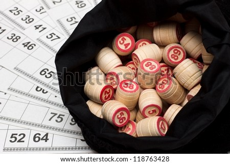 Lotto. Wooden kegs in a sack and game cards.
