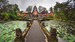 Lotus pond and Pura Saraswati temple in Ubud, Bali, Indonesia.