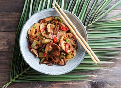 Lotus root or Rhizome stir-fry with Shiitake mushrooms, spices, hot peppers, dark soy sauce and green onions