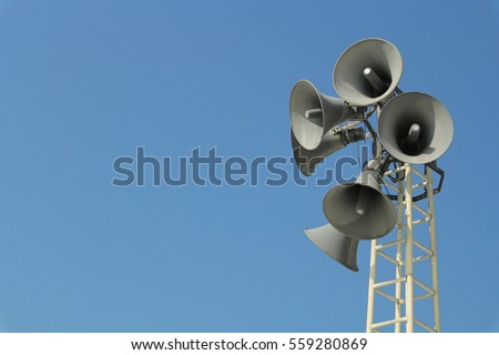 Loudspeaker warning system. System of alert for population. Sound amplifier with loudspeaker against the sky