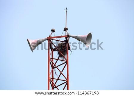 loudspeakers on a tall column