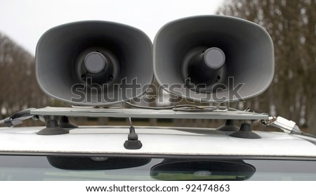 loudspeakers on car during a sports manifestation loudspeakers on car during a sports manistestation