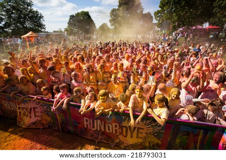 LOUGH CUTRA, GORT, IRELAND - SEPTEMBER 6: Unidentified people having fun and get showered in powdered dye during  annual RUN OR DYE, the 5K event, on September 6, 2014 in Lough Cutra, Gort, Ireland.