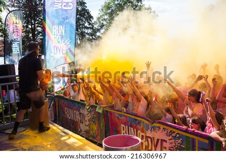 LOUGH CUTRA, GORT, IRELAND - SEPTEMBER 6: Unidentified people having fun get showered in powdered dye during  annual RUN OR DYE, the 5K event, on September 6, 2014 in Lough Cutra, Gort, Ireland.