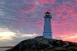 Louisbourg Lighthouse, Nova Scotia, Canada at sunset.