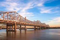 Louisville, Kentucky, USA with John F. Kennedy Memorial Bridge spanning the Ohio River at dusk.