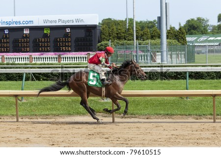 LOUISVILLE, KY - JUNE 18: Stephen Foster Day at Churchill Downs horse race track June 18, 2011 in Louisville, KY. Great Well (jockey Matthew Straight) finishes the race