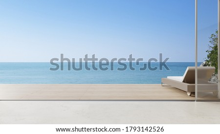 Lounge chair on terrace near living room in modern beach house or luxury villa. Cozy home interior 3d rendering with sea view. Stockfoto ©