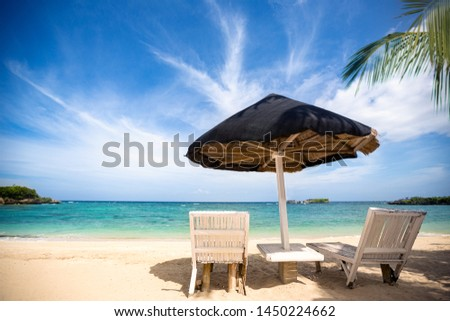 lounge chairs at tropical beach, Tropical resort with beautiful view #1450224662