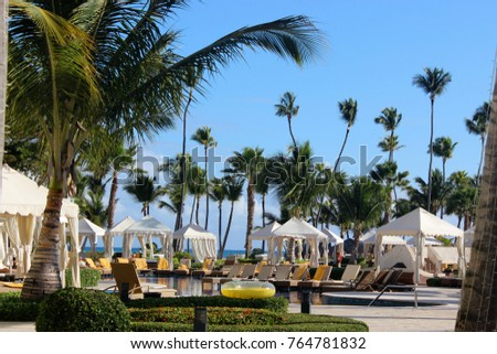 Lounge Chairs by Resort Pool #764781832