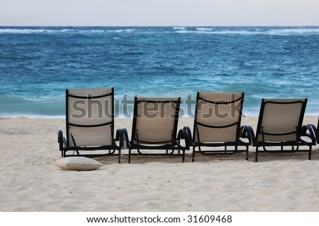 Lounge chairs on beach of Punta Cana, Dominican Republic