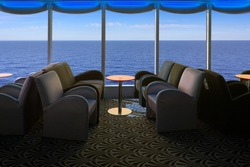 Lounge on a cruise ship, with tables and armchair