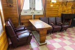 Lounge on the ship. Chairs and a table for playing chess.