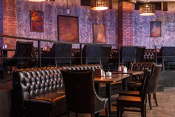 lounge place with brown leather sofa in nightclub