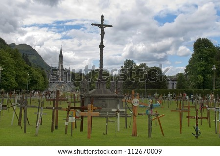 LOURDES, FRANCE - JULY 15: The Basilica of our Lady of the Rosary on July 15, 2012 in Lourdes. The Basilica is a Roman Catholic church in the Sanctuary of Our Lady of Lourdes ,  garden of crosses