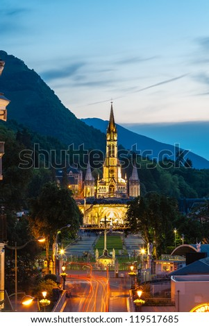 LOURDES, FRANCE - JUNE 06: The Basilica of our Lady of the Rosary on June 06, 2012 in Lourdes in France. Night view on the basilica during the evening procession with candles.