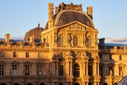 Louvre Museum facade at sunset. Paris, France