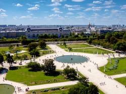 Louvre Palace Museum and green garden with fountain in Paris, view from above