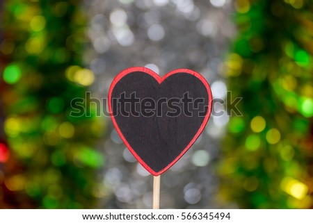 Love abstract background of light with blackboard wooden in heart shape for celebration valentine's day and wedding anniversary #566345494