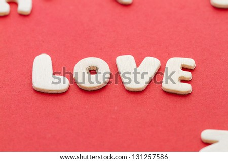 Love alphabet on red background