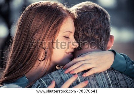 Love and affection between a young couple at the park