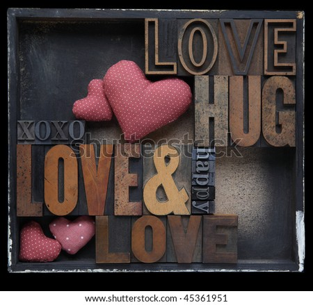love and related words in wood and metal letterpress type with fabric hearts in a box