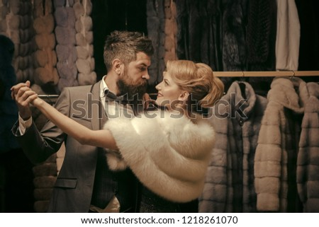 love and romance. love date of couple, man and woman dance among fur coat. #1218261070