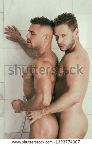 Love and romance. Two attractive guys in the shower. #1393774307