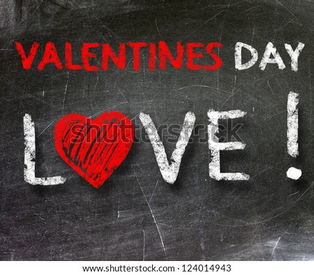 Love and valentines day written on a blackboard.