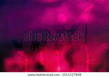 Love background, dark bright pink photo of a wet window with raindrops on it and handwriting word love, passion and desire concept, greeting card for Valentines day holiday #1011527848