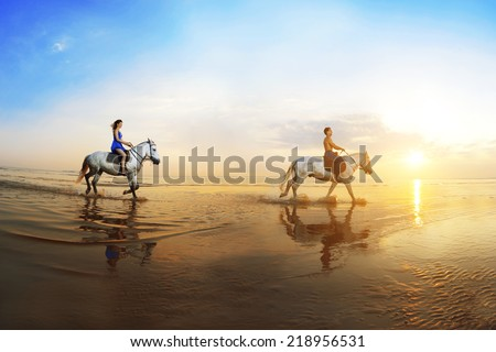 Love background. Family and horse in the sunshine. Couple in love on beach in sunset. Ride horseback of the sea in sun rays.