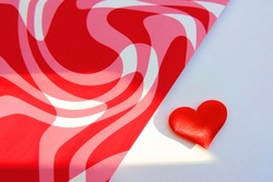love background. Romantic red card, template with red heart and abstract background with swirling red lines,  Copy, text space. Symbol of valentine's day. Light and shadow sunset