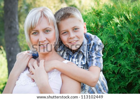 Love between mother and her son. Nature background.