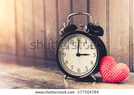 Love clock vintage tone timed 3 o'clock, Time of sweet loving past memories story on the old wood background. #577104784