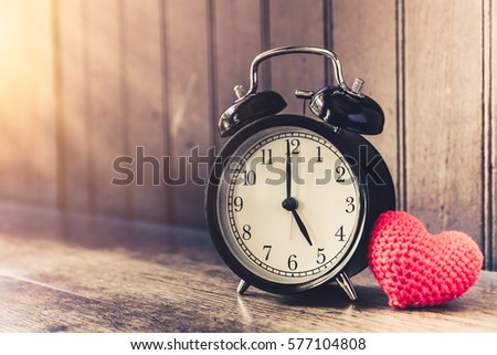 Love clock vintage tone timed 5 o'clock, Time of sweet loving past memories story on the old wood background. #577104808