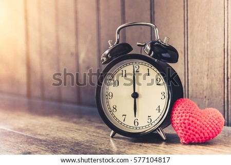 Love clock vintage tone timed 6 o'clock, Time of sweet loving past memories story on the old wood background. #577104817