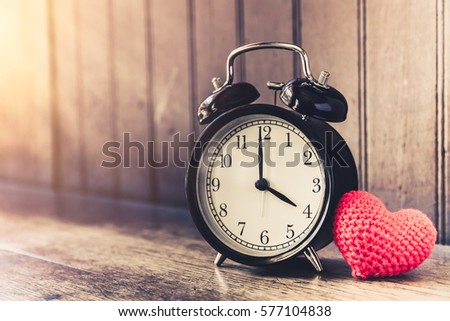 Love clock vintage tone timed 4 o'clock, Time of sweet loving past memories story on the old wood background. #577104838