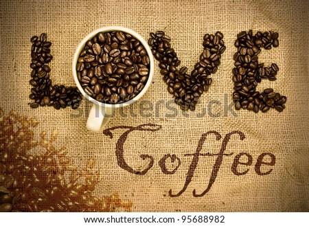 love coffee, coffee beans and mug used to spell love on hessian sack