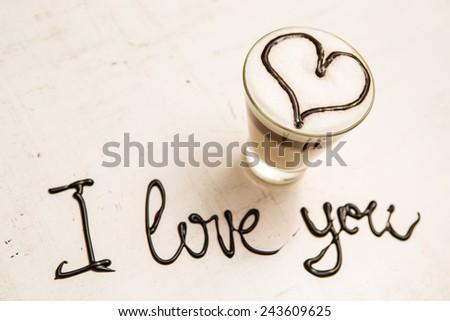 Love coffee cup and handwriting. I love you. Creative card
