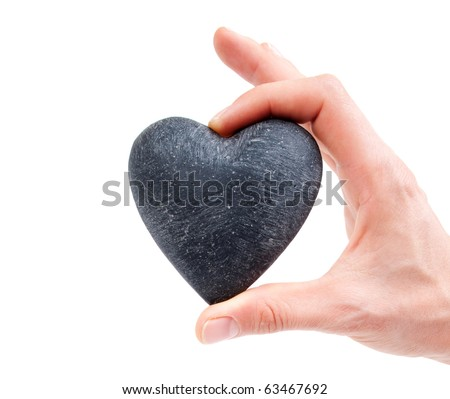 Love concept - female hand holding heart -