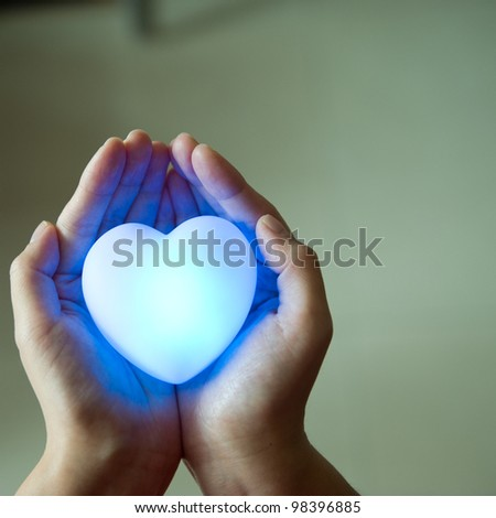 love concept. holding a heart in hands.