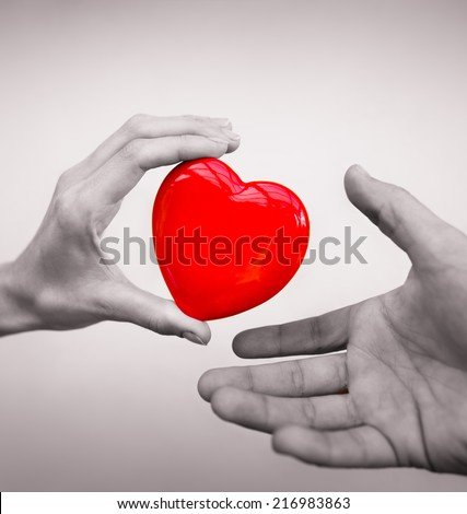 Love concept Woman giving a heart to man