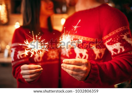 Love couple holds sparklers in hands, christmas #1032806359