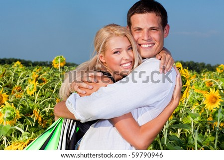 love Couple smiling under blue sky