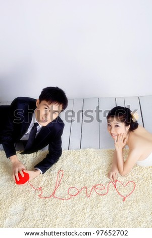 love couple spell word of love with ribbon